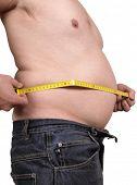 Color photograph measuring male abdomen