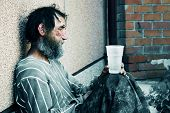 picture of tramp  - Homeless  in depression - JPG