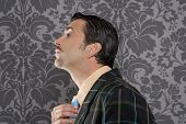 Nerd retro vintage businessman profile portrait mustache fixing neck tie