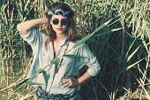 Beautiful hippie girl stands among the reeds. Spirit of freedom. Fashion shot. Bohemian, bo-ho style poster