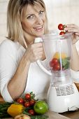 putting healthy greens in the blender
