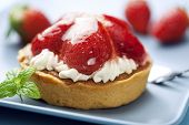 tart with fresh cream and strawberries