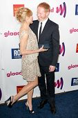 LOS ANGELES - APR 10: Jesse Tyler Ferguson (R) & Julie Bowen (L) arrive at the 22nd annual GLAAD Med