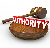 A judge's gavel and the word Authority symbolizing the control exercised by a person in a superior r