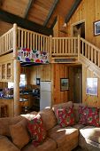 stock photo of cozy hearth  - Inside a beautiful wooden house in a ski resort - JPG