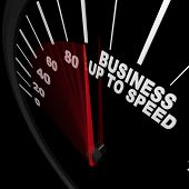 A speedometer with red needle racing to the words Business Up to Speed, representing a company or or