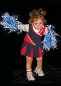 Little Cheerleader Cheering Over Black