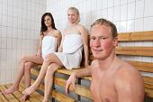 Group of people in a warm room at a sauna spa