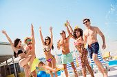 Sunny Pool Disco Party! Splashes Around. Group Of Six Sexy Multi Ethnic Excited Tourists Are Jumping poster