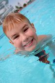 Boy Swimming In Swimming Pool