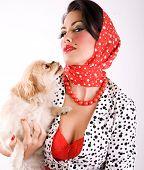 beautiful woman holding cute puppy