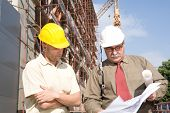 image of engineering construction  - engineers at the construction site - JPG