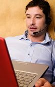 man with headphones surfing the net