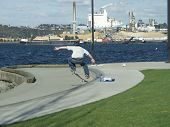 Skateboarder By Water