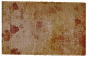 stained brown hand-made paper background with petals