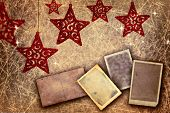 set of antique picture borders on gold shiny background with red stars