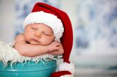 Portrait Of A Newborn Baby Boy,l Wearing Christmas Hat, Sleeping poster