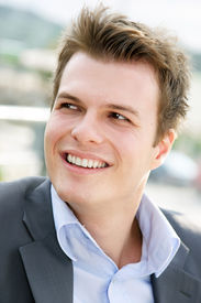 stock photo of early 20s  - happy young man in his early 20s - JPG