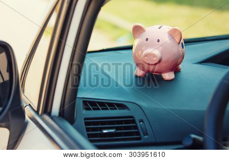 poster of Pink Piggy Money Box Inside A Car Transportation. Saving Money For Vehicle Purchase. Successful Fina