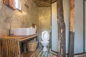 Flush Toilet And Sink In Country Loft Interior Design Room. Interior Design Toilet Room Include Flus poster