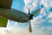 Aircraft Propeller And Spinner Engine On Airplane Wing Against Cloudy Blue Sky. Four Blade Aircraft  poster