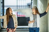 Vape Teenagers. Two Young Cute Girls In Casual Clothes Smoke Electronic Cigarettes Outdoors In The S poster