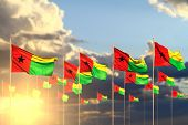 Nice Memorial Day Flag 3d Illustration  - Many Guinea-bissau Flags On Sunset Placed In Row With Soft poster