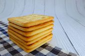 Cracker Squares Stacked, Cracker Squares Stacked On Plaid Fabric, Cracker Squares Stacked On White W poster