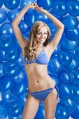 Swimsuit And Balloons In Blue, Both Her Arms Are Raised