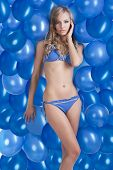 Swimsuit And Balloons In Blue, She Has Left Hand On The Face