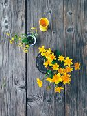 Yellow Fresh Wild Flowers In Colorful Ceramic Vase, On Wooden Veranda Background. Still Life In Rust poster