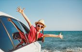 Happy Child Girl Goes To Summer Travel Trip In The Car poster