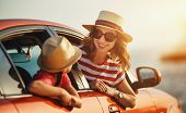 Happy  Family Mother And Child Girl Goes To Summer Travel Trip In The Car poster