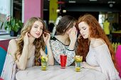 Beautiful Girl Overhears Girlfriends Gossip. The Concept Of Lifestyle, Gossip, Lies, Friendship. poster
