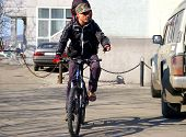 picture of sakhalin  - Man on bicycle travels on city - JPG