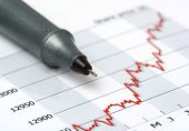 Gray Pen On Growing Share Price Chart