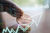 Investment Dividend Concept With Penny In Hand High Quality poster