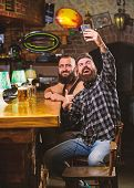 Take Selfie Photo To Remember Great Evening In Pub. Online Communication. Man Bearded Hipster Hold S poster