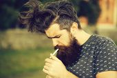 Handsome Sexy Bearded Young Man Hipster With Long Beard And Mustache Has Stylish Hair On Serious Hai poster