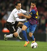 BARCELONA - FEB 19: Jonas Gonasalves of Valencia CF vies with Cristian Tello of FC Barcelona during