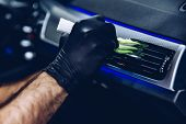 Man Worker In Car Wash Cleaning Car Air Vent. Car Detailing poster