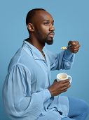 Young Man As A Medieval Grandee On Blue Background. Portrait Of Male African-american Model In Retro poster