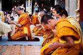 CHIANG MAI, THAILAND - FEBRUARY 4: Buddhist monks praying on evening religion ceremony in Doi Suthep