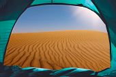 view out of a tent situated in the desert, tourism concept poster