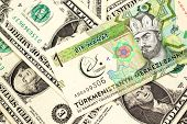 A One Manat Bank Note From Turkmenistan Close Up In Macro With An Assortment Of American One Dollar  poster