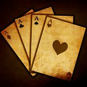 pic of playing card  - Poker table with soft center focus and cards - JPG
