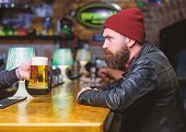 Man With Beard Spend Leisure In Dark Bar. Brutal Lonely Hipster. Hipster Relaxing At Bar. Brutal Hip poster