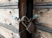 Wooden Weathered Antique Gates Closed With Padlock poster
