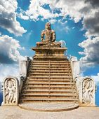 Statue Of A Meditating Buddha Against The Sky. A Collage Of Many Of My Images.