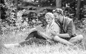 Romantic Date At Green Meadow. Couple In Love Spend Leisure Reading Book. Romantic Couple Students E poster